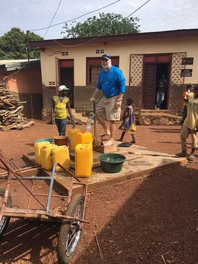 Taking my turn on the water well pump at an orphanage in Bangui, CAR